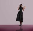 fashion model wearing black dress and sunglasses