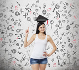 Brunette lady is presents a necessity of higher education. Graduation hat above her head. Educational icons are drawn over the concrete background. poster