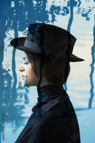 Double exposure of girl wearing hat and abstract water backgroun - 86387403