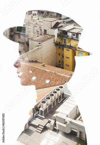 Double exposure of girl wearing hat and cityscape roofs - 86387685
