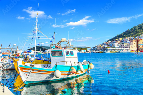 Aluminium Colorful boats over clear water in peaceful Greek bay, Greece