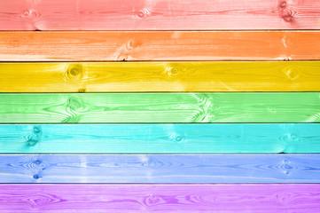 Pastel colorful rainbow painted wood planks background © Delphotostock