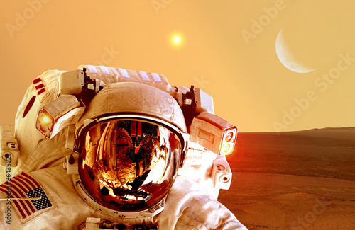 Foto op Canvas Baksteen Astronaut spaceman helmet space planet Mars apocalypse moon. Elements of this image furnished by NASA.
