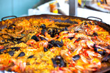 Naklejka Traditional paella with seafood in a market