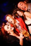 Fototapety People in night club. Dancing, drinking and having fun