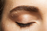 Fototapety Close-up of closed eye eyelashes and eyebrows brown with water drops