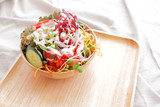 Fototapeta Salad with cream in wooden bowl
