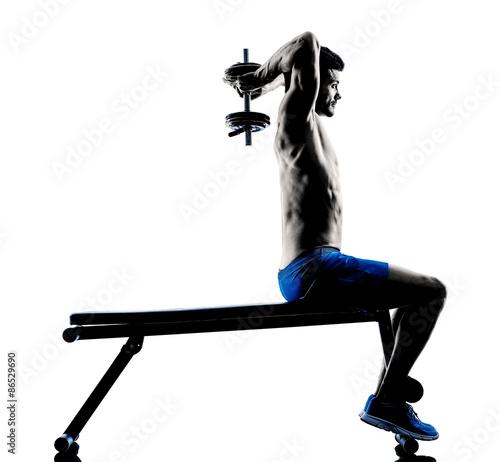 Fototapeta man exercising fitness weights Bench exercises