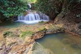 Fototapeta Beautiful little waterfall in forest