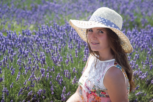 Young woman in lavender field with hat © Dmytro Surkov