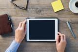 Businesswoman holding digital tablet - 86583020