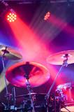 drum kit under stage spotlights