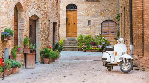 Zdjęcia na płótnie, fototapety na wymiar, obrazy na ścianę : Italian streets in the Tuscan small town and a popular single-tr