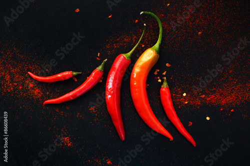 Poster Chili peppers on a black background