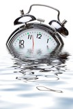 close-up view of the oldfashioned alarm clock in water poster