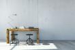 Schreibtisch vor Wand aus Beton