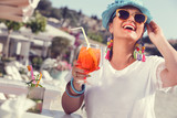 Woman holding glass of cocktail - Fine Art prints