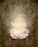 Fototapety Gentle Healing Words - Female cupped hands with the word 'healing' floating above surrounded by a healing word cloud on a swirling misty sepia colored energy background