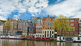 Distinctive old houses near the canal on cloudy sky background i poster