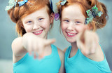 Fototapety Portrait of two cheerful redhead twins