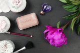 spa and make up tools with peony flower
