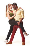 Fototapety Young couple dances Caribbean Salsa, studio shot