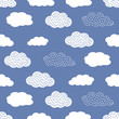 Seamless pattern with white clouds on blue background. - 86743647