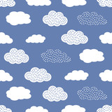 Seamless pattern with white clouds on blue background.