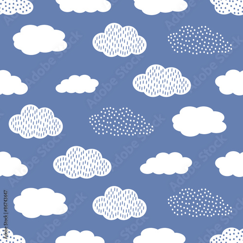 Fototapeta Seamless pattern with white clouds on blue background.