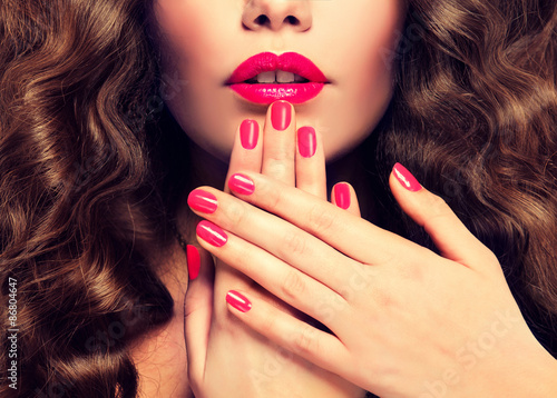 Poster Beautiful girl showing crimson  manicure