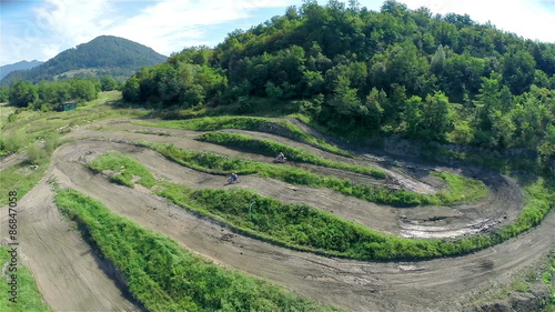 Foto op Canvas Snelle auto s Aerial wide shot of motocross racer jumping