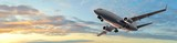 Modern Passenger airplane flight in sunset panorama