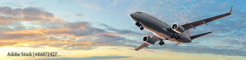 Fototapeta Modern Passenger airplane flight in sunset panorama