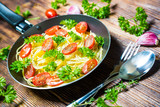 Fototapeta Pasta with cherry tomatoes and fresh herbs