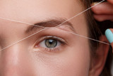Woman during eyebrow threading