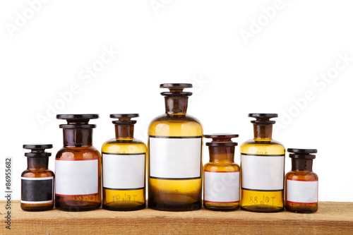 Tuinposter Apotheek Various vintage pharmacy bottles with blank labels on wooden boa