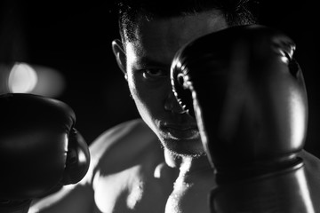 Boxing man ready to fight. black and white