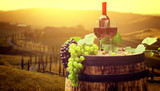 Fototapety Red wine with barrel on vineyard in green Tuscany, Italy