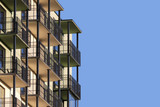 Modern apartment building with balconies - 87009633