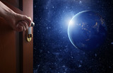 room with open door.Planet earth from the space. Some elements of this image furnished by NASA - Fine Art prints
