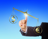 Euro Sign Outweighing The Dollar On A Balance poster