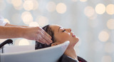 Fototapety happy young woman having salon hair wash