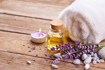 Spa still life with lavender oil, white towel and perfumed candle on natural wood © Floydine