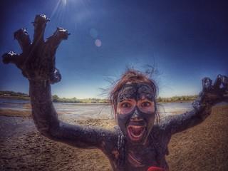 Woman in healing mud