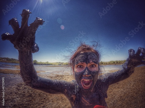 Woman in healing mud