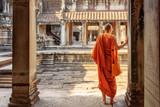 Buddhist monk exploring courtyards of Angkor Wat, Siem Reap