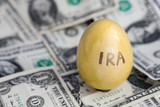 IRA retirement saving golden egg on cash poster