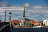 Quay Riga with St. Peter and the ships on the river in the summe