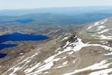 Panoramic view from Gaustatoppen mountain at sunny summer day, T