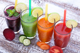 Fototapeta Vegetables, fresh juices mix fruit healthy drinks on wood table.